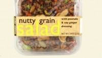 Trader Joe's nutty grain salad has 21g of protein and contains red quinoa, spelt, pistachios, peanuts, pumpkin seeds and edamame with a Thai-style, soy ginger dressing