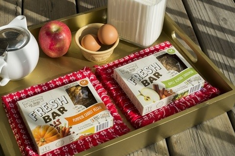 Five friends hand make their refrigerated snack fresh bar for Food bar manufacturers
