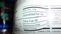 How many products making '0g trans-fat' claims still contain partially hydrogenated vegetable oil (PHOs)?