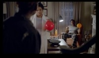 In a still from the new Sparkling ICE ad campaign, a teenage boy creeps into the house after a late night, and is challenged by his parents - and the family dog, who have been inhaling helium from balloons...